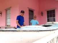 JR and Scott admiring an old Bahamian Sloop at the museum.