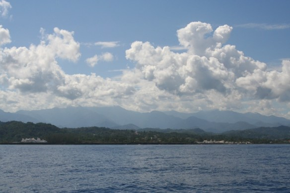 North coast of Jamaica. Trident Castle is the white building on the left, with the Blue Mountains in the background.