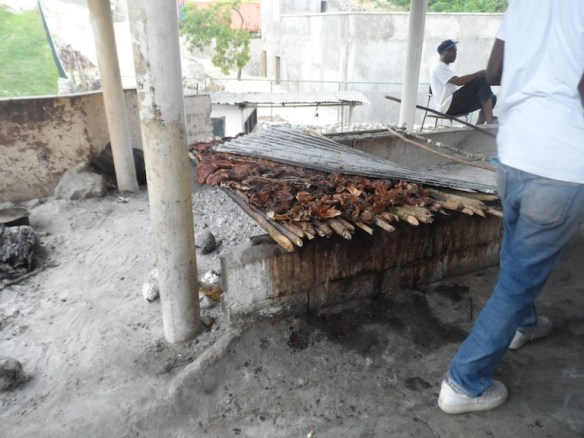 Jerk pork- cooked over a woodfire and covered with that rusty looking corugated metal sheet. Newspaper for pot-holders. Sheets of paper for plates. A tree stump for a cutting board.... delicious! :)