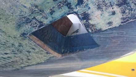 En revanche, le puits de moteur n'accroche pas le grattoir.