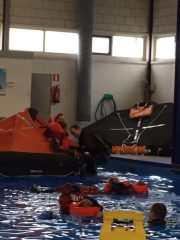 Climbing into life raft
