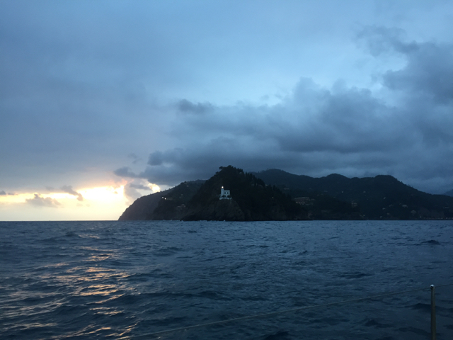 Approaching Portofino lighthouse at dusk