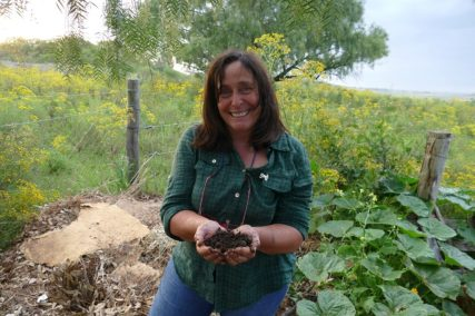 Alda proudly presents the secret of her success: healthy soil