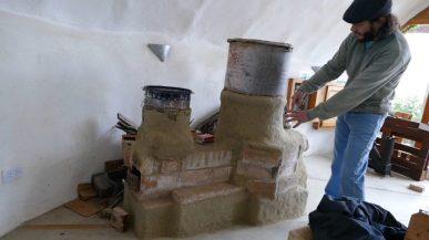 Alejandro explains how the rocket-woodstove works
