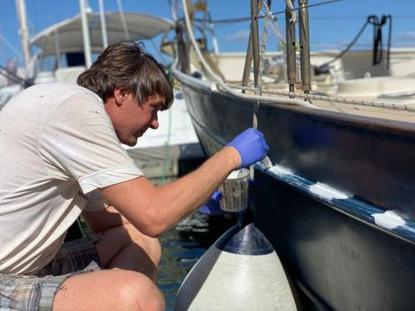 Ivar painting the hull