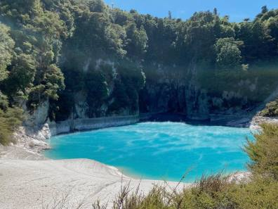 Very blue and very warm water in the volcanic valley lake