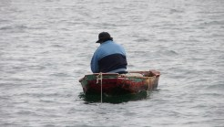 man in little boat