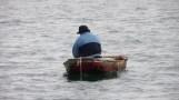 man in little boat