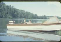 Mac Irwin in his runabout up the West River.