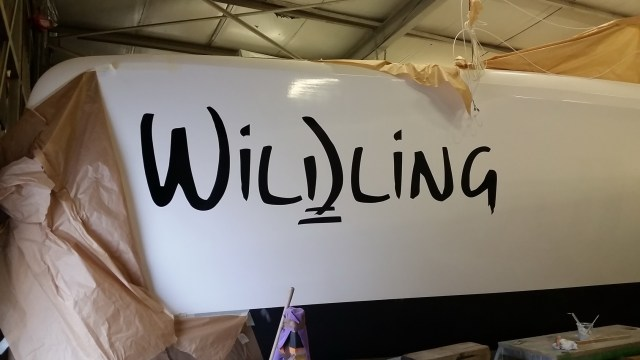 Applying the boat name graphics