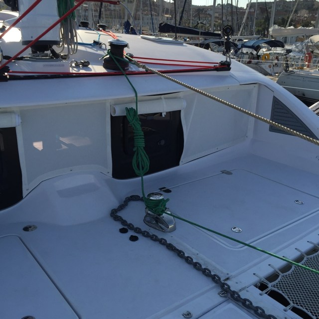 Using the windlass capstan to pull in the mooring line. I've added a loop onto the end of the mooring line and hooked it over the winch beside the mast, so if the pulling line were to slip the mooring line will stay attached