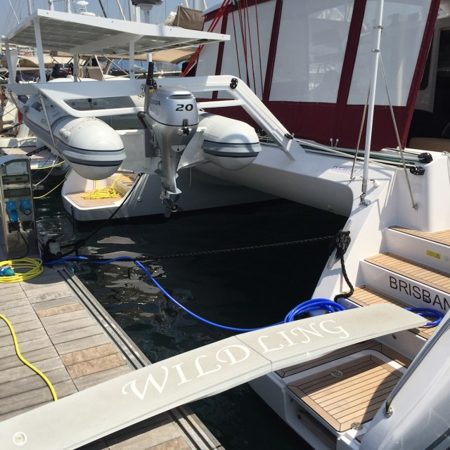 Attach spring lines from each inside stern cleat to stop the stern from moving out of position