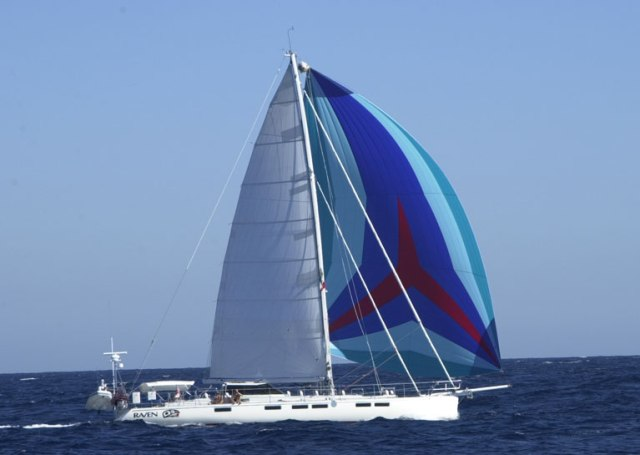 Assymetric spinnaker reaching downwind. Notice the much more curved luff than the code-D allowing it to twis more to windward and generate more power at deeper angles.