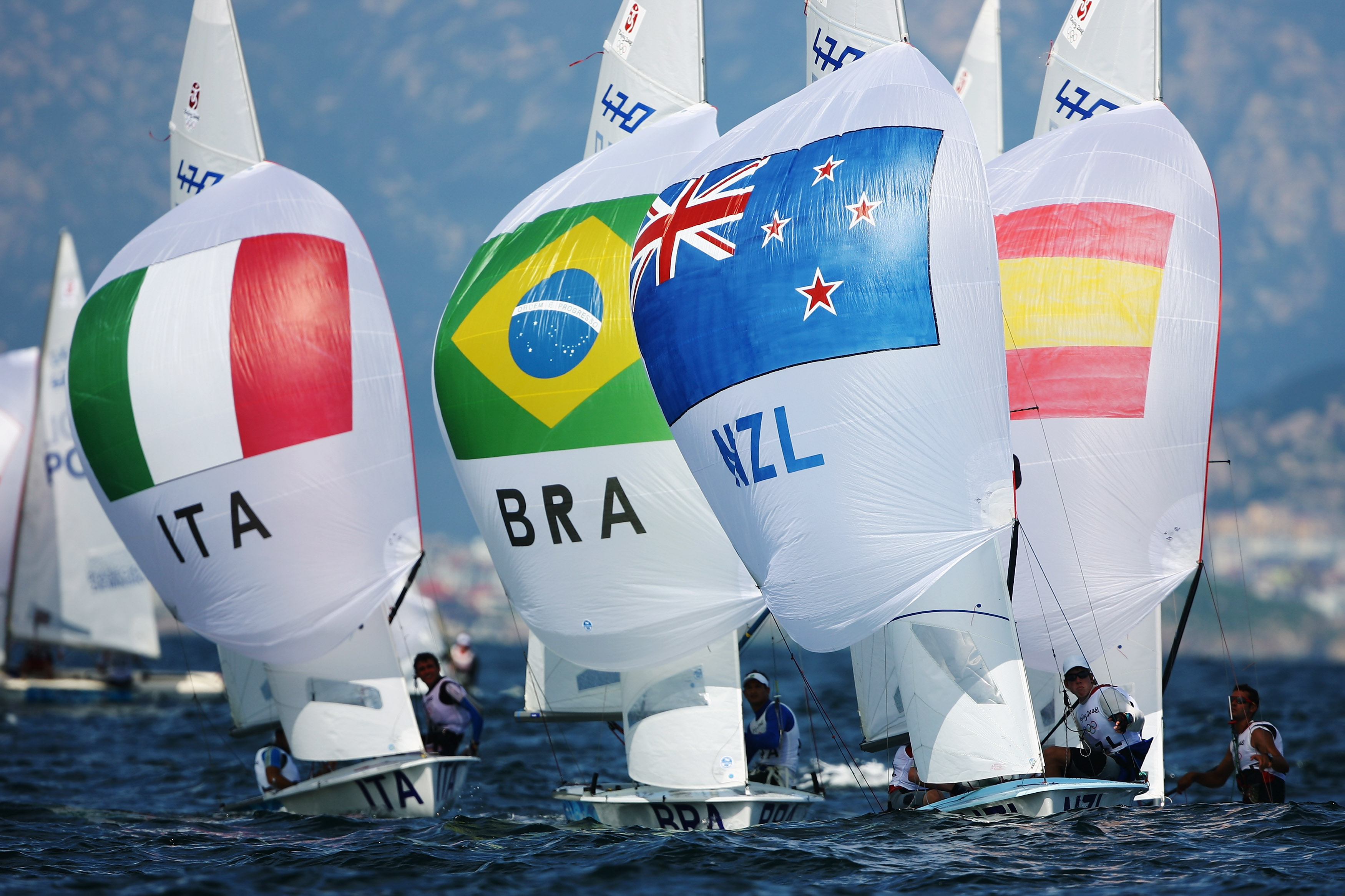 QINGDAO, CHINA - AUGUST 11: (L-R) Gabrio Zandona' and Andrea Trani of Italy, Fabio Silva and Samuel Albrecht of Brazil and Carl Evans and Peter Burling of New Zealand compete in the 470 Men's class race held at the Qingdao Olympic Sailing Center during day 3 of the Beijing 2008 Olympic Games on August 11, 2008 in Qingdao, China. (Photo by Clive Mason/Getty Images)