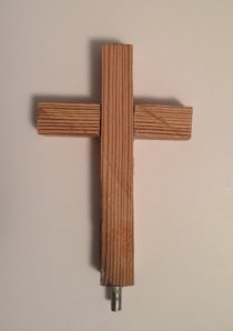 A piece of Michalina Buczkowska's original wooden cross from St. Adalbert's Cemetery has found a home in St. Adalbert Basilica. During the 2014 dedication of Michalina's new wooden cross, smaller crosses made from the original cross were distributed to those in attendance. One of these has been painted gold and used to replace the cross that was missing from the base of the 6th Station of the Cross - Veronica Wipes the Face of Jesus. All fourteen stations now have small gold crosses once again.