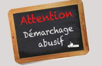 Ardoise d'écolieravec la mention Attention Démarchage abusif