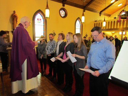 Father introduces the candidates to the Parish and asks for their acceptance.