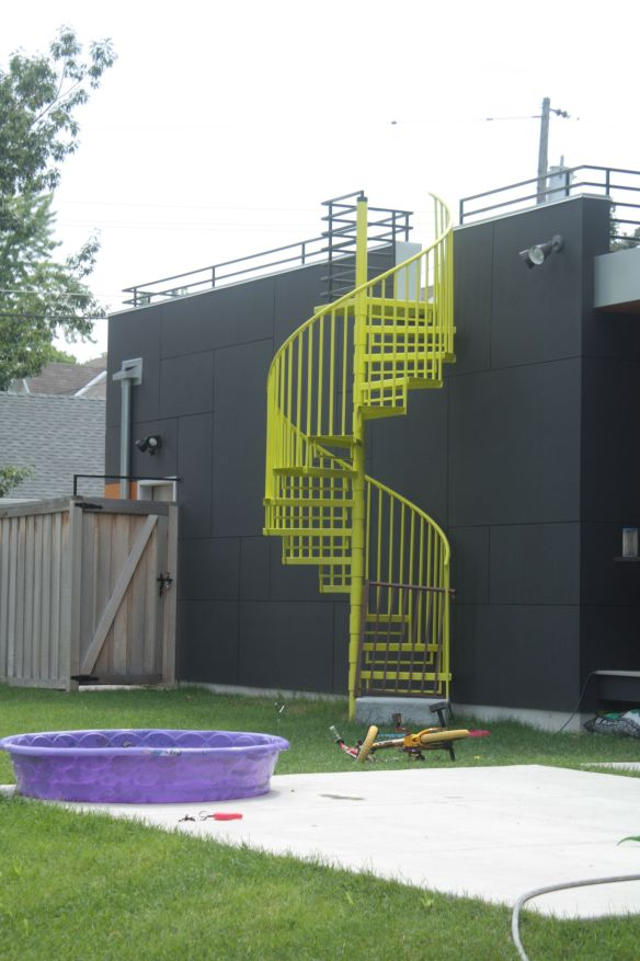 The spiral staircase to the second story patio.