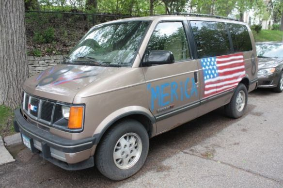 """I assume (and hope) this GMC van honoring """"'merica """" and Dale Earnhardt Junior is tongue-in-cheek. It's parked across from the scooters and 235 Exeter."""