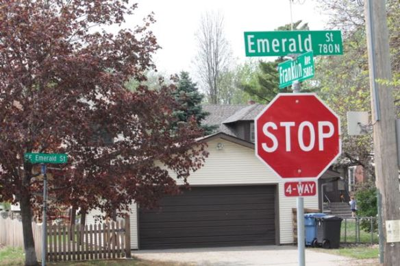 Emerald Street is the border of Saint Paul and Minneapolis and both cities post street signs. Saint Paul's is on the post above the stop sign; Minneapolis' is in the background. Interesting to note that in Saint Paul, the street is Emerald Street North but in Minneapolis called it's East Emerald Street.