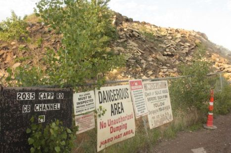 A dizzying array of signs awaits all who venture to this recycling plant.