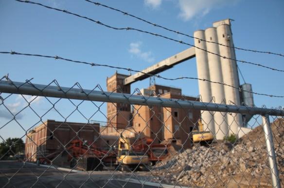 Construction equipment to convert the old Schmidt Brewery into the Schmidt Artists Lofts.
