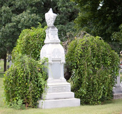 The curtain or drapes on the top of the Michel family marker symbolizes the end of life on earth.