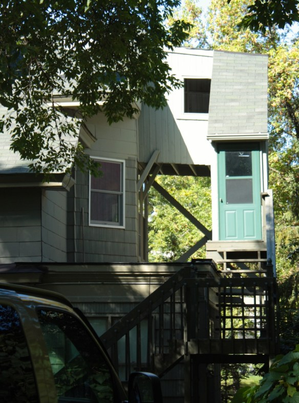 This is a look at the back of 586 Lincoln and the definition of ingenuity. The way I imagine it, the homeowner decided to convert this house to a rental and city code requires two exits from the third floor. Simple-build a 10 foot skyway (the white structure with the square window) to an enclosed stairway (right, with shingled roof) which leads to an exterior stairway. Well played,sir!