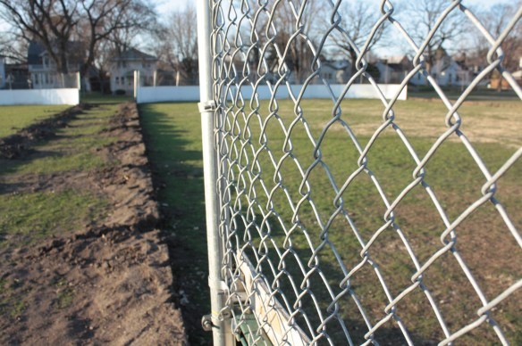 The removal of the hockey rink signals the re-emergence of the ball field.