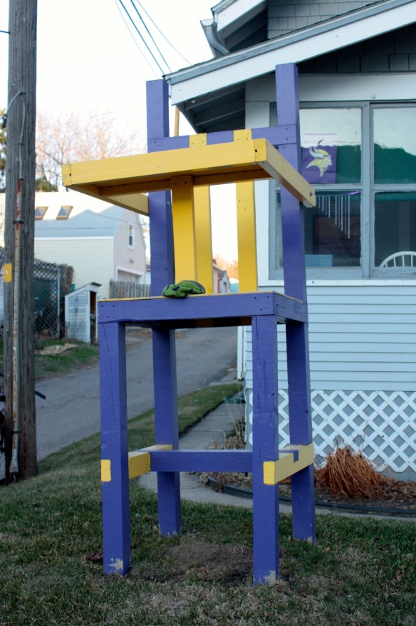 """A jumbo high chair, tinted in Minnesota Vikings'  purple and gold, shouts out to all, """"Vikings fans live here!"""" and """"This is a bachelor pad!"""" 672 Fairview Avenue North."""