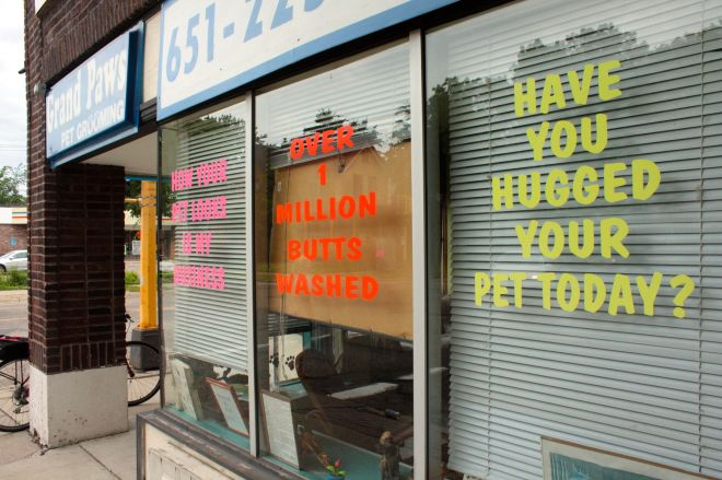 """Across Hamline from Groundswell is Grand Paws Pet Grooming. There are signs in four windows along Hamline but the notice that garners the most attention has to be the one with the orange lettering. Yes, it says, """"Over 1 million butts washed."""""""
