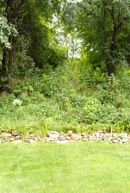 """According to Frank, the steep slope in the backyard has meant battling land slides, """"We had three major slides and the last one was like four years ago, but I think that's the end of it because it's (the dirt) found its own level."""