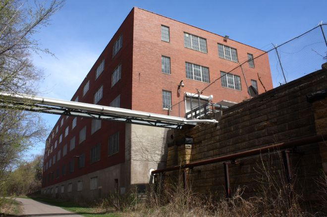 One of the unused buildings of the long-shuttered Hamm's Brewery. The pipes from one building to another when the brewery expanded. At one time, Reany crossed over the Hollow here.