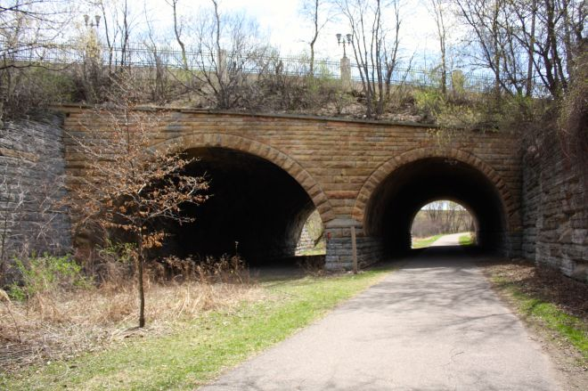 The Seventh Street Improvement Project is a bridge with two tunnels that, for more than 100 years, routed as many as five tracks of the Saint Paul and Duluth Railway under East Seventh Street as vehicles crossed above. (6)