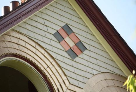 The meticulous detail on the shakes on the front of the house.