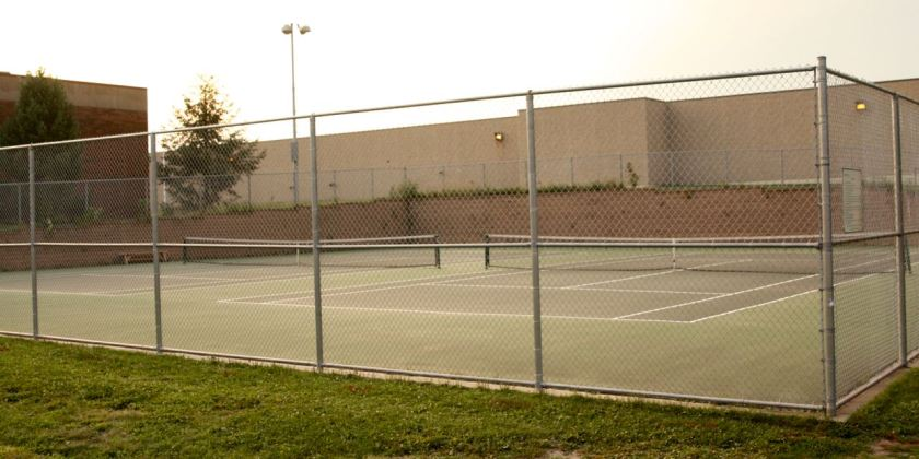 """These tennis courts are dedicated to Ernie """"Duke"""" Greene, an early African American champion of tennis in Saint Paul."""