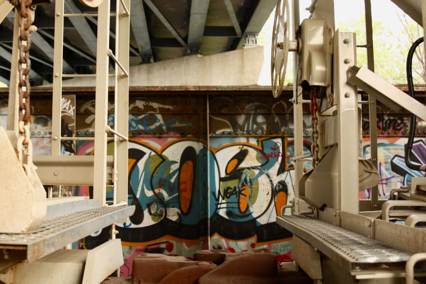 The extent of the graffiti on the railroad bridge is apparent when I looked between two hopper cars. Above is the Pelham Avenue bridge over I-94, railroad tracks and St. Anthony Avenue.
