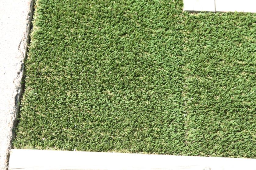 You practically have to get down in the turf to find the seams.