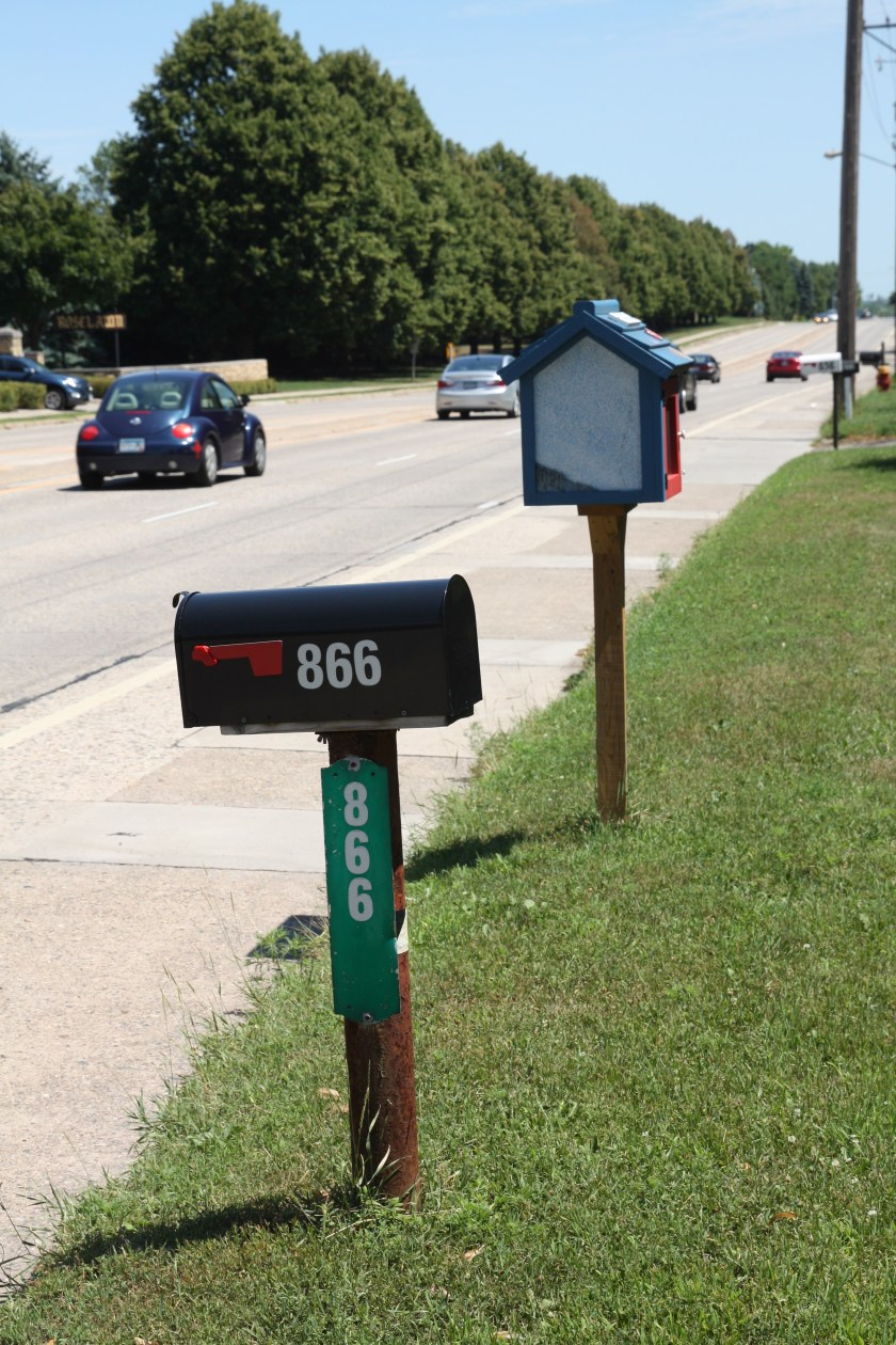 Mailboxes and a Little Free Library in the 800 block of Larpenteur Avenue West.