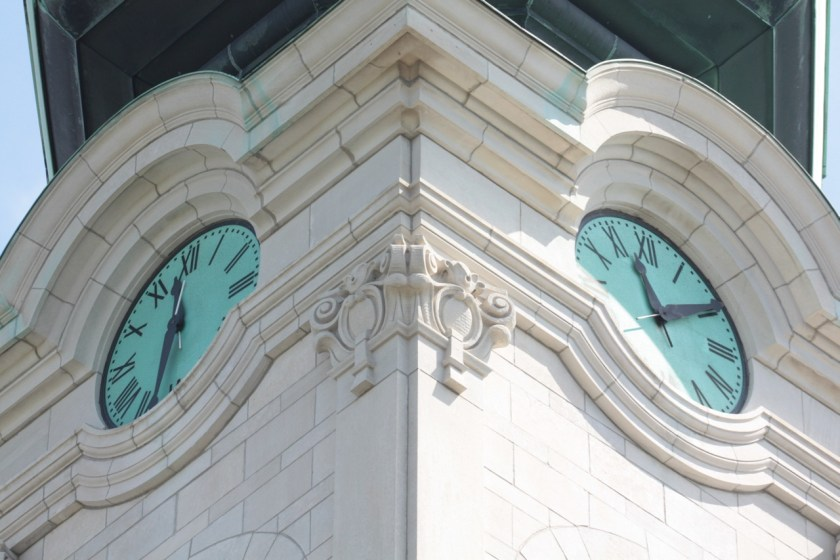A four-sided clock sits above the bells. Notice that the two clocks each display a different time. (Neither was correct.)