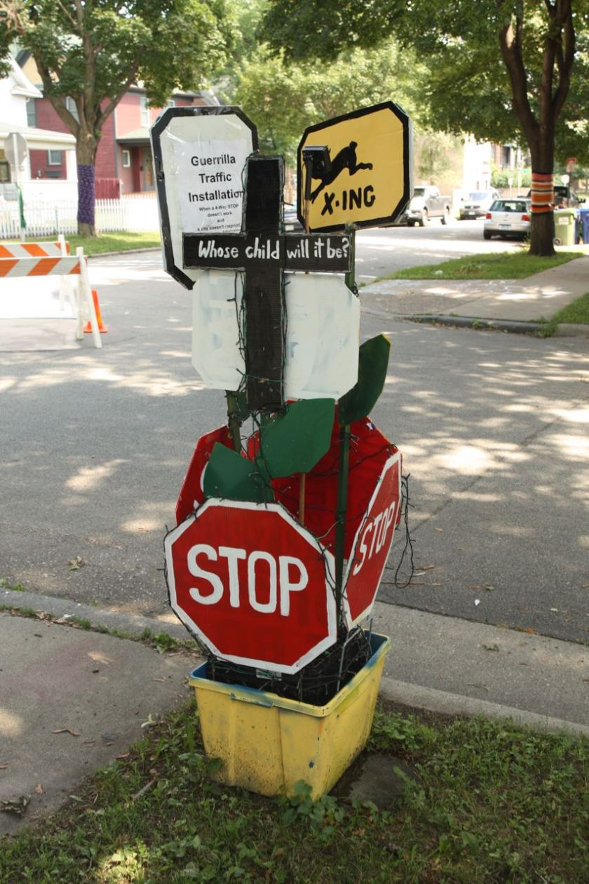 The homemade four-way stop sign and self-described Guerilla Traffic Installation at Fourth and Bates, created by Sage Holben.