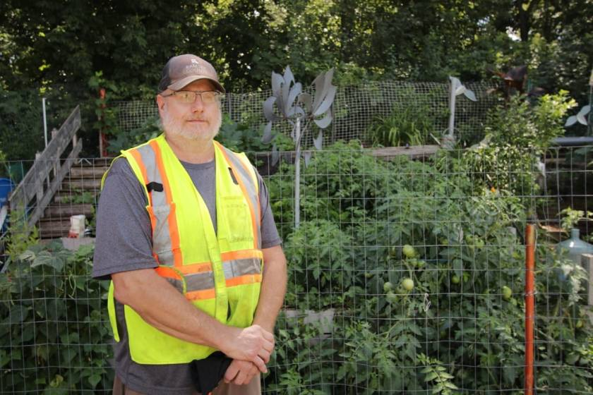 Jeff Hehn, Battle Creek Yard Waste Site Supervisor, stands in front of the waste site's garden, which he started from scratch in 2016.