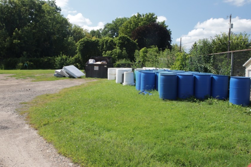 Extra recycling and garbage bins are stored on the property of the former Mounds Park.