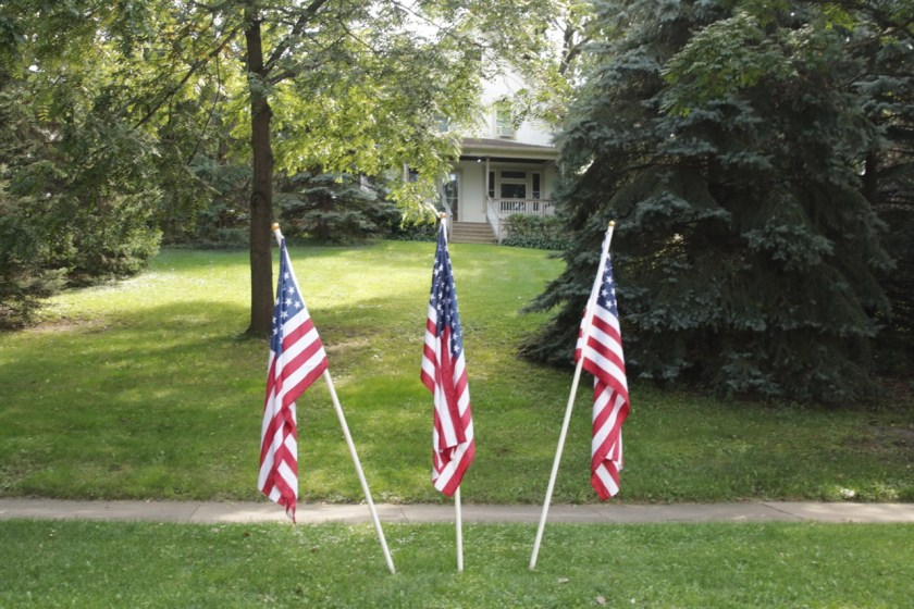 Flags in front of 1010 Burns Avenue.
