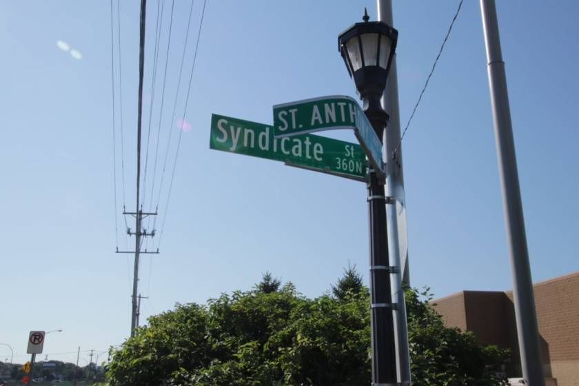 Something - perhaps a tall truck - did a number on the St. Anthony Avenue sign at Syndicate Street.