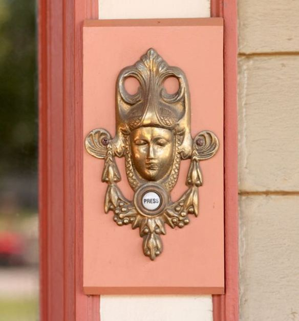 The doorbell button is framed by what the Ernsts call a 'creepy lady.'
