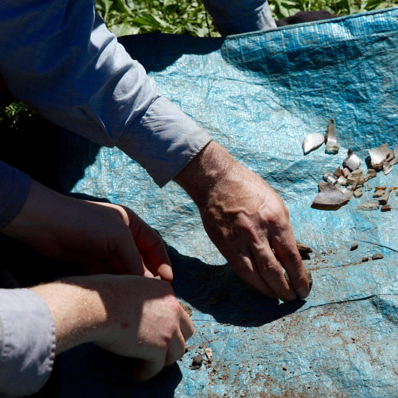 A volunteer separates shards of pottery uncovered during the dig.