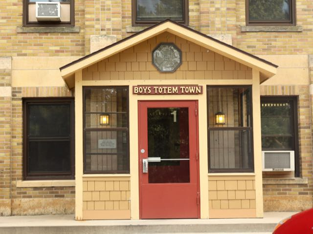The entrance to the main building at Boys Totem Town.
