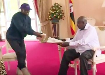 Kanye West gives Ugandan President Yoweri Museveni a pair of West's Yeezys line of sneakers. (Photo courtesy of YouTube)