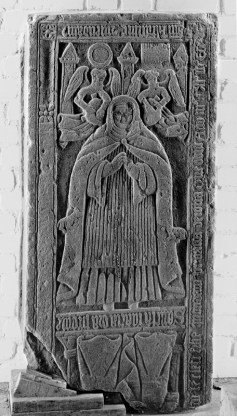 Grave slab on Abbess Anna McLean, d. 1543 at Iona Nunnery. The bottom half of the slab is broken off, but has the Virgin Mary on it